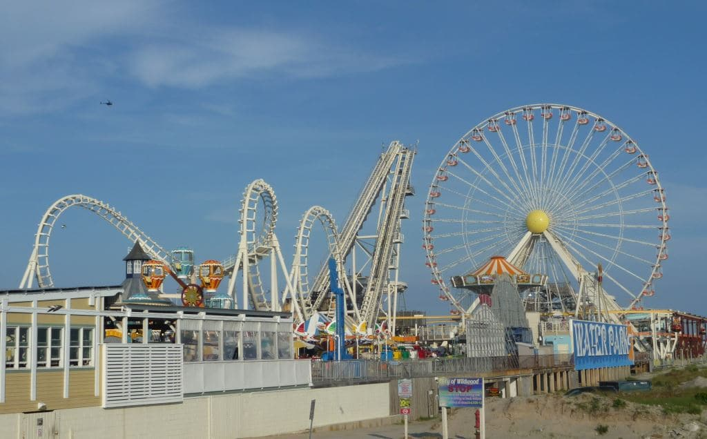 Piers over sand with roller coasters on them. Yes please.